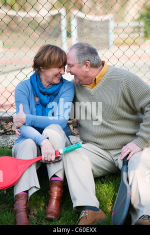 Older couple touching foreheads - Stock Photo