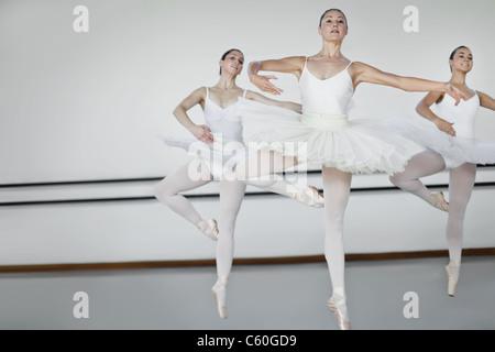 Women in ballet costumes dancing - Stock Photo
