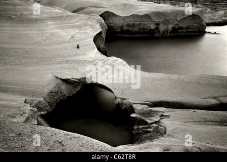 Milos island, volcanic rocks in Sarakiniko beach (slow shutter speed-black & white version). - Stock Photo