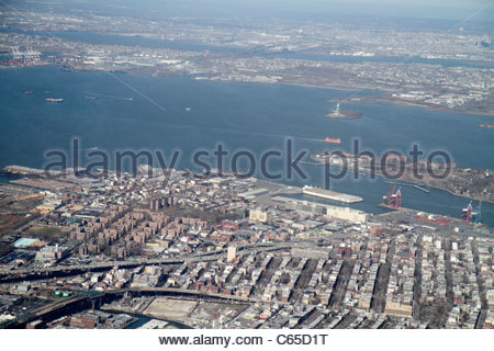 New York New York City NYC LaGuardia Airport aerial American Airlines aircraft arriving flight window seat view - Stock Photo