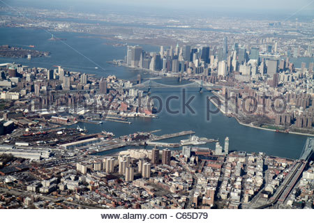 New York New York City NYC LaGuardia Airport aerial American Airlines arriving flight aircraft window seat view - Stock Photo