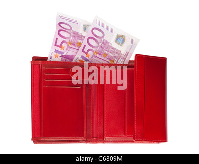 Red wallet with two five-hundred-euro banknotes isolated over a white background. - Stock Photo
