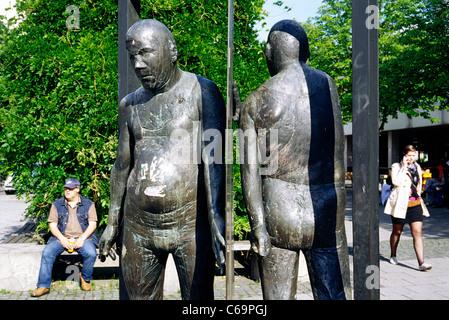 Bronze sculpture 'Mann in Drehtür' by Waldemar Otto (1986) in front of Goethe University at in Frankfurt am Main. - Stock Photo