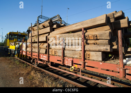 Trainload of wooden decommissioned old railroad sleepers , Finland - Stock Photo