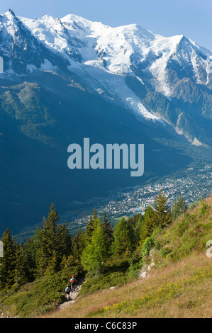 HIkers hiking in Flegere, above Chamonix, opposite of the Mont Blanc range. - Stock Photo