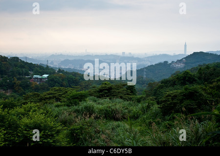 View over Taipei city on a misty day from mountains at Maokong Gondola, Taipei, Taiwan - Stock Photo