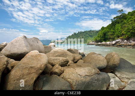 Rocks on the beach of Paya, Berjaya Tioman Island Resort in the back, Pulau Tioman Island, Malaysia, Southeast Asia, - Stock Photo