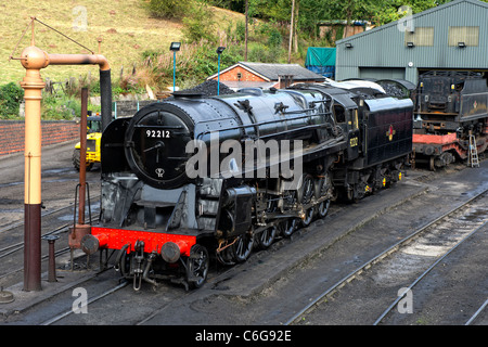 British Railways Standard Class 9F locomotive No. 92212  in the sidings at Bridgnorth Station on the Severn Valley - Stock Photo