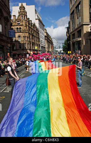Giant rainbow flag at Manchester Gay Pride Parade, Manchester, England - Stock Photo