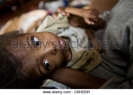 A malnourished young child in an orphanage - Stock Photo