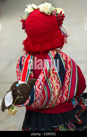 Girl walking in a market, Pisac, Sacred Valley, Cusco Region, Peru - Stock Photo