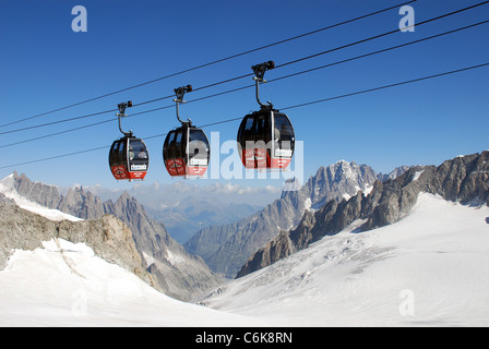cable cars cross the Mont blanc glacier on route from the Helbronner telepherique station on the way to Aiguille - Stock Photo
