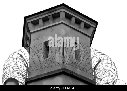 Watchtower with barbed wire, black and white photo - Stock Photo