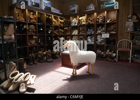 The interior of shop at Sheep World farm and nature park. Auckland, North Island, New Zealand. Wool lined slippers - Stock Photo