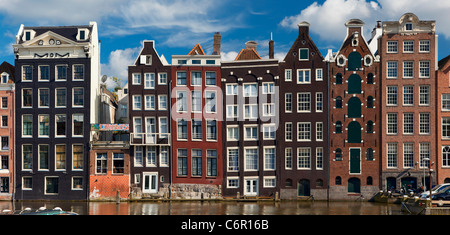 Europe, Netherlands, Amsterdam, Row Houses along the Canal - Stock Photo