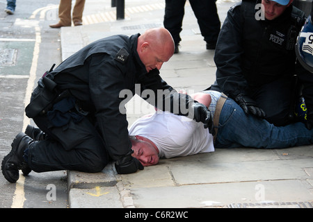 EDL supporter arrested by police during a demonstration held by the EDL. - Stock Photo