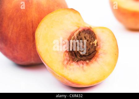 Prunus persica. Peach on a white background - Stock Photo