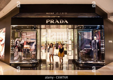 Customers leaving the Prada store, Ion shopping mall, Singapore Asia - Stock Photo