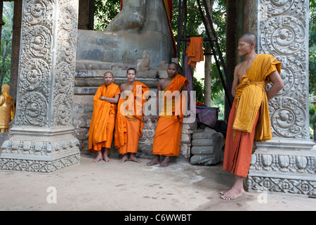 Group of Young Monks at temple in Angkor Wat. - Stock Photo