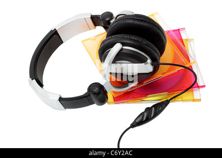 Stereo headphone and compact disks in colorful plastic cases on white background - Stock Photo