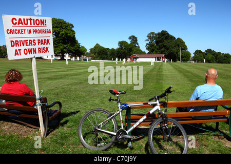 Sign warning drivers about parking next to cricket ground while a match is in progress , Southborough Common , Kent - Stock Photo