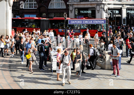 London street scene people around entrance to Oxford Circus Underground tube station at this busy shopping area - Stock Photo