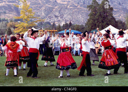 Portuguese Folk Dancers dancing in Traditional Costume at annual Festival of the Grape, Oliver, BC, British Columbia, - Stock Photo