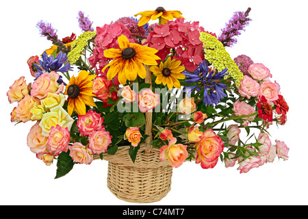 Flower arrangement in a basket isolated on a white background - Stock Photo