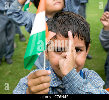 Portrait of a school girl holding the Indian flag - Stock Photo