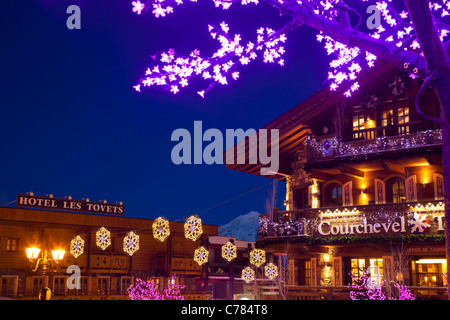 Courchevel 1850 at dusk with Christmas decorations, Courchevel 1850, France. - Stock Photo