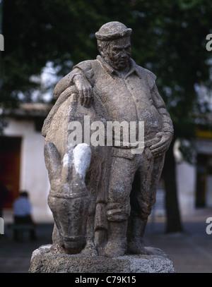 Sancho Panza. Character in the novel Don Quixote, by Miguel de Cervantes. Statue, Malagon. Spain. - Stock Photo
