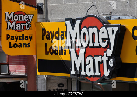 Payday Loans Sign on store front, Money Mart. - Stock Photo