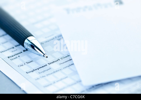 Blank credit application form with envelope and pen close up - Stock Photo