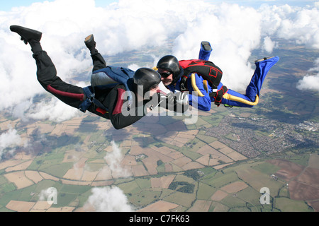Two skydivers doing formations - Stock Photo