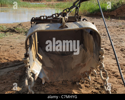 Spade of old excavator in a sand quarry. - Stock Photo