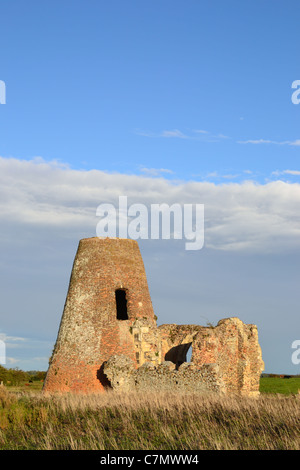 Ruins of St Benets Abbey and windmill beside the River Bure on the Norfolk Broads - Stock Photo
