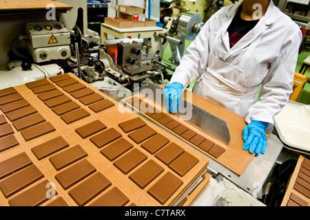 Switzerland, Giubiasco, Stella chocolate factory, making chocolate candy - Stock Photo