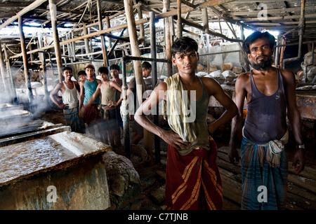 Bangladesh, workers in salt plant - Stock Photo