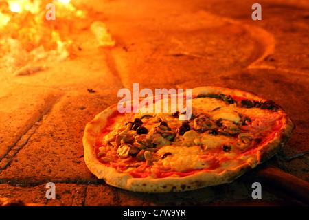 Italy, Campania, Naples, pizza - Stock Photo