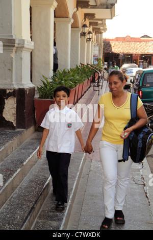 Nicaragua Granada Granada Square Calle Vega colonial heritage historic district sidewalk Hispanic woman boy child - Stock Photo