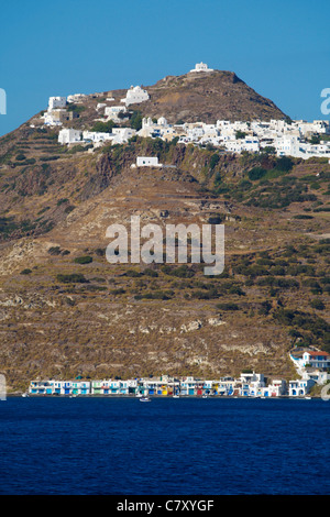 The picturesque village of Klima at the coast and the village of Plaka at the hill in Milos island Greece - Stock Photo