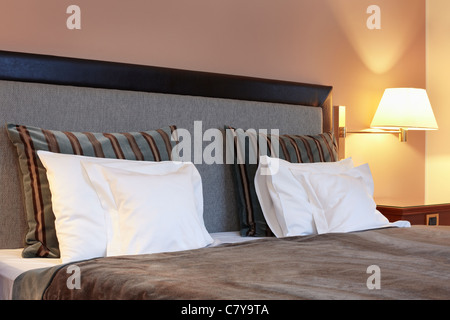 Hotel bedroom, bed and pillow - Stock Photo