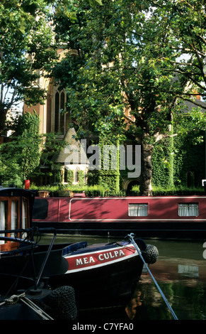 Boats docked on the Regents Canal, Camden Town, London, England, UK - Stock Photo
