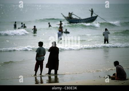 India, Orissa, Puri,fishermen on beach - Stock Photo