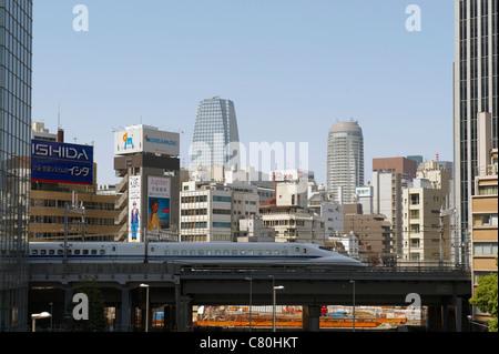 Japan, Honshu, Tokyo,Shinkansen Bullet Train and City Skyline - Stock Photo