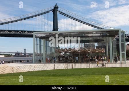 The historic Jane's Carousel in Brooklyn Bridge Park near the Manhattan Bridge in New York City. - Stock Photo