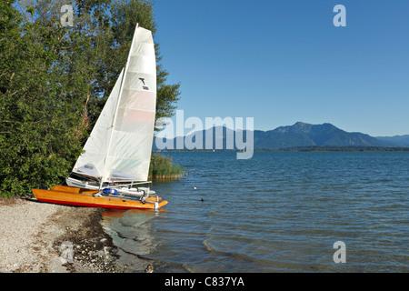 Beached Catamaran, Fraueninsel, Chiemsee, Chiemgau,Upper Bavaria, Germany, Europe. - Stock Photo