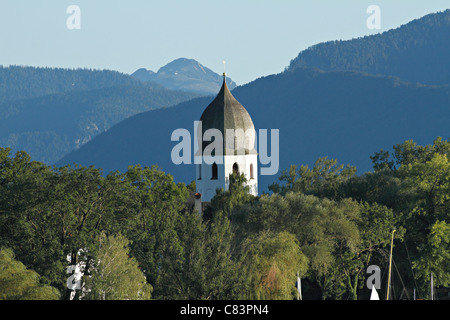 Church tower with clock, bell tower, the Benedictine monastery Frauenwoerth, Fraueninsel island, Lake Frauenchiemsee - Stock Photo