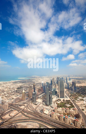 View over skyscrapers and roads in Dubai city - Stock Photo