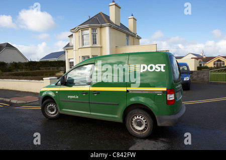 green an post irish postal service delivery van in small rural town of enniscrone county sligo republic of ireland - Stock Photo